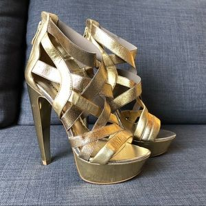 **NEW** Bebe gold platform strappy leather heels 7